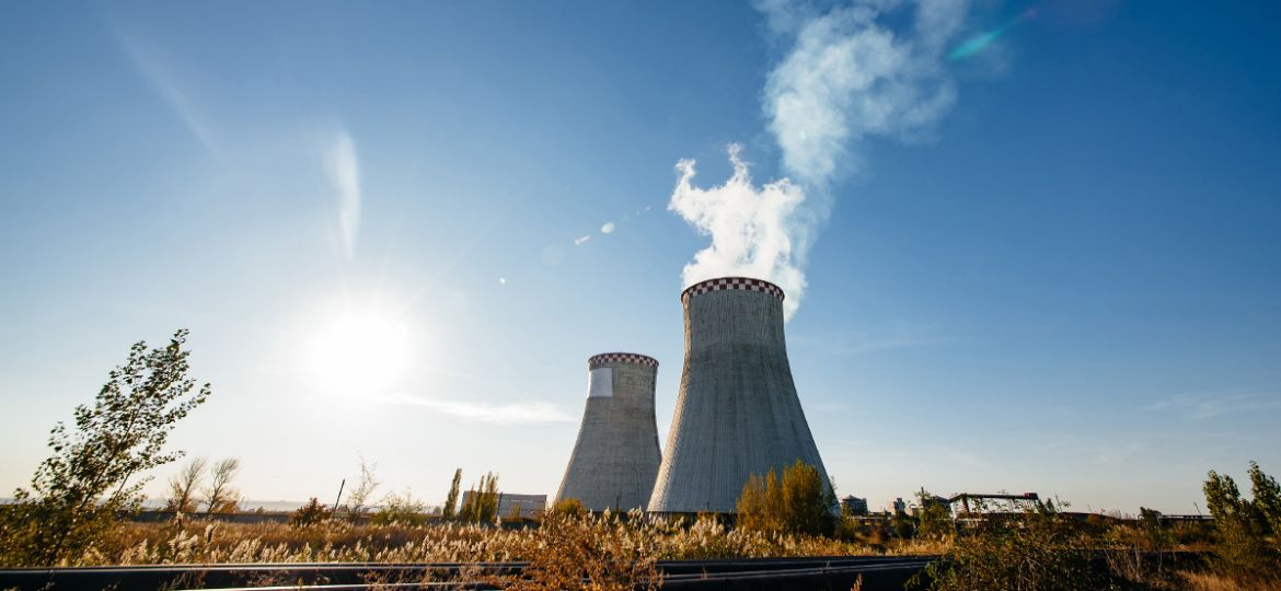 smoking-pipes-thermal-power-plant-against-blue-sky